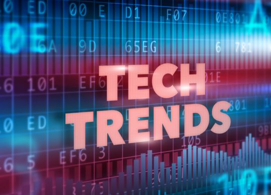 Tech Trends concept red text with graphs